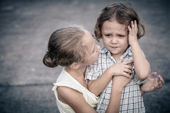 Portrait of sad teen girl and little boy Stock Photography