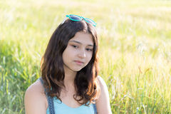 Portrait of sad teen girl on nature Royalty Free Stock Photo