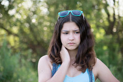 Portrait of sad teen girl on nature Royalty Free Stock Image