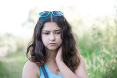 Portrait of sad teen girl on nature Stock Photography