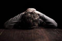 Sad teenage boy. Portrait sad teenage boy on a black background stock images
