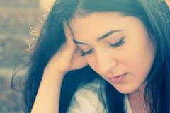 Portrait of a sad teenage girl. Outdoor portrait of a sad teenage girl stock images