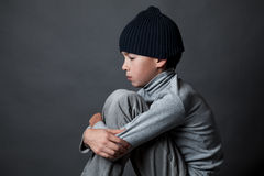 Portrait of sad teenager on gray background, Royalty Free Stock Photos