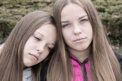Portrait of sad twins stock photography