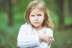 Portrait of sad unhappy little girl. Little sad child is lonesome. upset and distraught angry facial expression. Portrait of sad unhappy little girl. Little sad royalty free stock photos