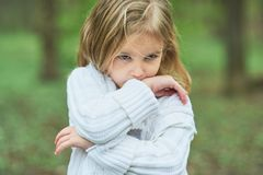 Portrait of sad unhappy little girl. Little sad child is lonesome. upset and distraught angry facial expression. Portrait of sad unhappy little girl. Little sad stock images