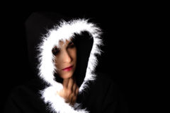 Portrait of sad woman in black cape artistic conversion Royalty Free Stock Image