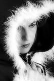Portrait of sad woman in black cape black and white Stock Image