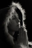 Portrait of sad woman in black cape praying Stock Photography