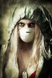 Portrait of Sad woman in breathing mask. Post apocalypses world halloween concept. Portrait of young Sad woman in breathing mask Royalty Free Stock Images