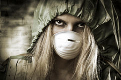 Portrait of Sad woman in breathing mask. Post apocalypses world halloween concept. Portrait of young Sad woman in breathing mask Royalty Free Stock Image