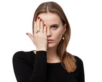 Portrait of a sad woman, one eye is closed by the hand Royalty Free Stock Images