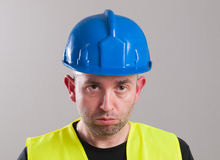 Portrait of a sad worker Stock Photos