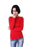 Portrait of sad worried woman with hand on chin.  Royalty Free Stock Photos