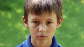 Portrait Of Sad Young Caucasian Boy Looking At Camera