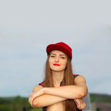 Portrait of sad young girl. In the cap Royalty Free Stock Image