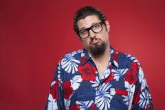 Portrait of a sad young man in Hawaiian shirt Royalty Free Stock Photo