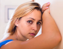Portrait of sad young woman at home Royalty Free Stock Photos