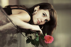 Portrait of sad young woman with red rose Stock Image