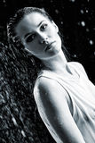Portrait of sad young woman in water studio. Black and white Royalty Free Stock Photography