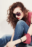 Portrait of a sad young woman wearing sunglasses Royalty Free Stock Photography