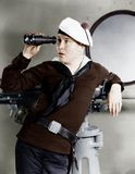 Portrait of sailor looking through binoculars Royalty Free Stock Photos