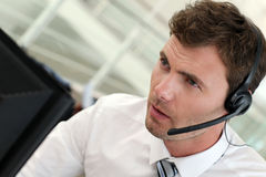 Portrait of salesman with headset working. Portrait of salesman with headset on Stock Photos
