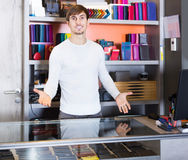 Portrait of salesman selling wallets and purses in store Royalty Free Stock Photo