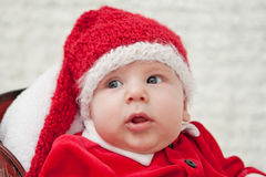 Portrait of Santa baby in knitted cap Royalty Free Stock Photo