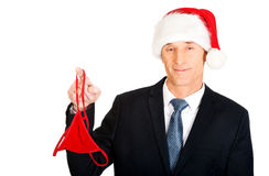 Portrait of santa businessman with female thongs Stock Photos