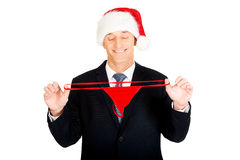 Portrait of santa businessman with female thongs Stock Photography