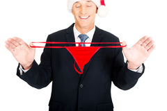 Portrait of santa businessman with female thongs Royalty Free Stock Photography