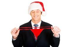 Portrait of santa businessman with female thongs Royalty Free Stock Photos