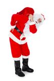 Portrait of santa carrying sack. Over white background Stock Image