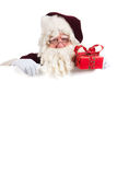 Portrait Santa Claus. Portrait of the real Santa Claus with present and white board Stock Images