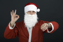 Portrait of Santa Claus with a bag of presents and looking at hi Royalty Free Stock Photo