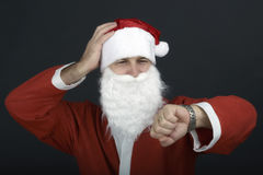 Portrait of Santa Claus with a bag of presents and looking at hi Royalty Free Stock Photography