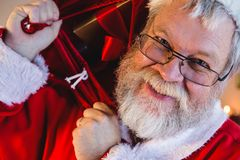 Santa claus carrying his gift sack Stock Image