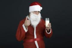 Portrait of Santa Claus Drinking milk Stock Photo