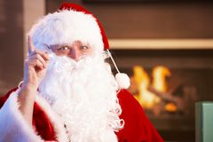 Portrait of Santa Claus by fireplace Royalty Free Stock Image