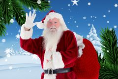 Portrait of santa claus gesturing against digitally generated background Stock Photo