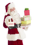 Portrait Of Santa Claus With Gifts And Open Sign royalty free stock images