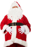Portrait of Santa Claus grabbing his belly Stock Image
