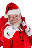 Portrait of santa claus holding christmas bag and gesturing Stock Image