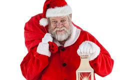 Portrait of santa claus holding christmas bag and lantern Royalty Free Stock Photography