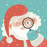Portrait of Santa Claus with magnifying glass Royalty Free Stock Photography