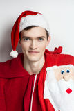 Portrait Santa Claus. Man Santa Claus role-play passion. Perfect Christmas look, spectacular male makeup.  handsome guy model light background New Year Christmas Royalty Free Stock Images