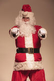 Portrait of Santa Claus pointing at the camera Royalty Free Stock Photo