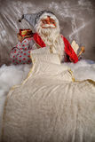 Portrait of Santa Claus reading the. Santa Claus doll reading Christmas wish list, space for text Royalty Free Stock Image