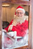 Portrait of santa claus reading novel during christmas time Stock Photos